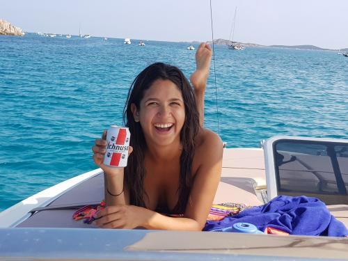Girl on board a boat in Tavolara