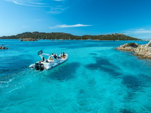 Inflatable boat in the crystal clear waters