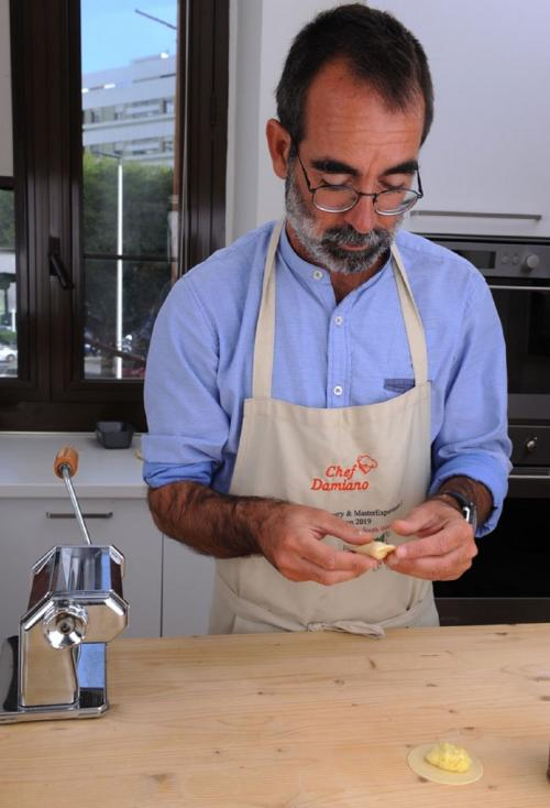 Chef shows the preparation of culurgiones during the cooking class