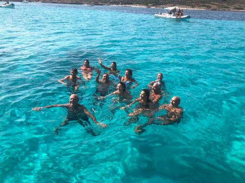 Group of friends swims in the Asinara sea
