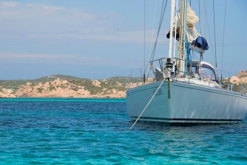 Sailboat in the crystal clear sea of the La Maddalena Archipelago