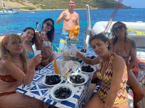 Group of passengers on board during lunch on the catamaran