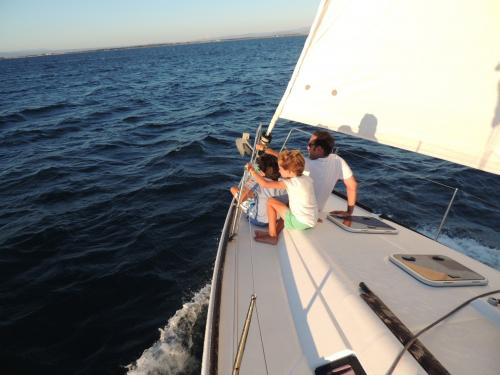 Father and son aboard a sailboat