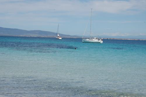 Sailboat in the crystal clear sea