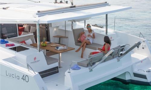 Girls aboard a luxury catamaran