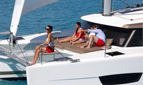 Passengers sunbathe aboard a luxury catamaran