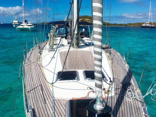 Sailboat among the crystal clear sea