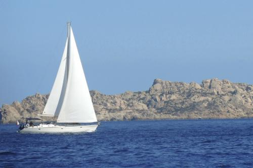 Sailboat during weekly charter in northern Sardinia