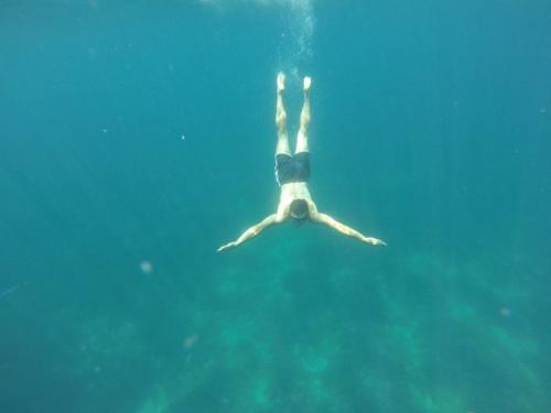 Boy snorkeling in the waters of Alghero