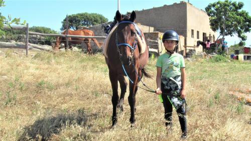 Child and horse riding in Sedini