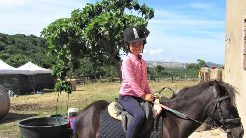 Little girl on horseback in Sedini