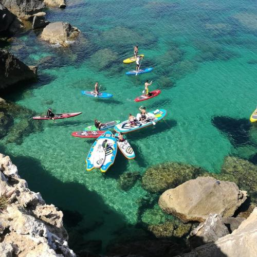 Group of people in SUP on the coast of Oristano