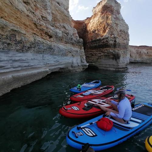 SUP and rocks overlooking the sea in the territory of Oristano