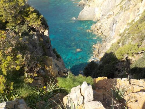 Trekking route overlooking the crystal clear sea