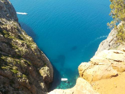 Dinghy in the crystal clear sea of Buggerru