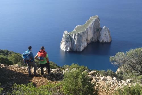 Hikers in front of Pan di Zucchero in Masua