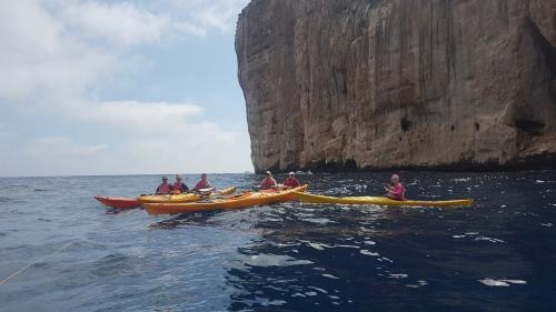 People kayaking among the most beautiful coves on the coast of Alghero