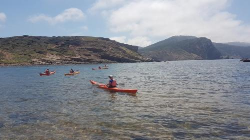 Group of hikers in kayaks in the coast of Alghero