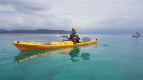 Kayak hiker in the sea of Alghero