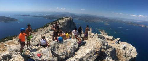 Group of hikers on the summit of Tavolara