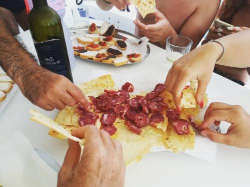 Sardinian aperitif served on board a catamaran