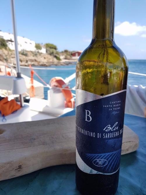 Vermentino wine served on board a catamaran