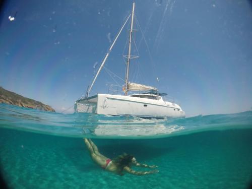 Catamaran and girl snorkeling on day tour