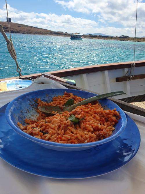 Pasta served aboard a vintage sailing ship