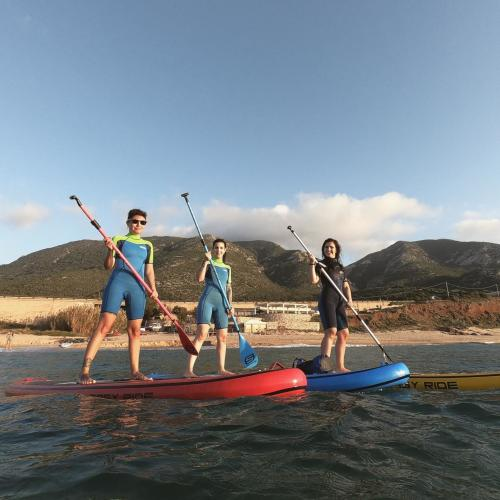 Girls on the SUP in the sea of Buggerru