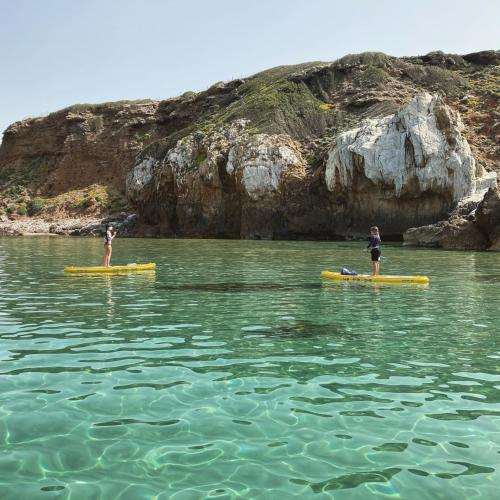 SUP hikers in the crystal clear sea
