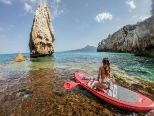 Girl on SUP in the sea of Buggerru