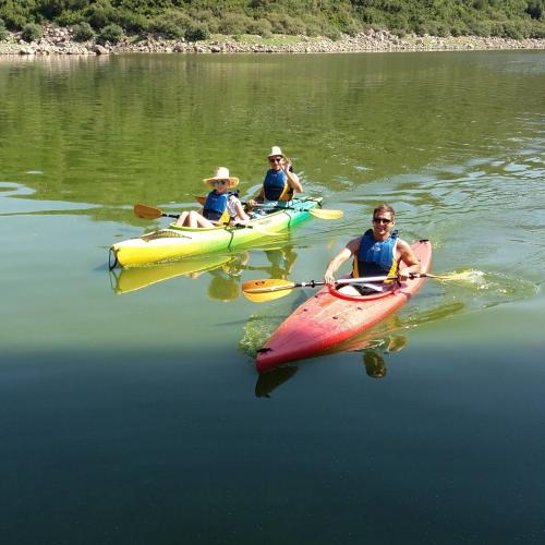Double and single canoe with hikers