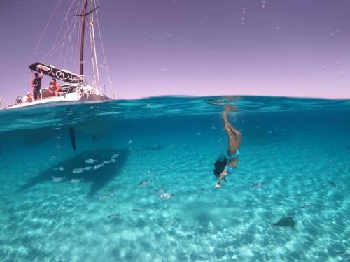 Girl snorkels at Asinara during stay