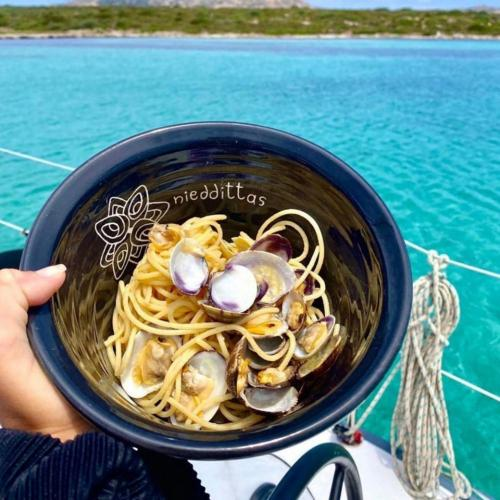 Spaghetti with clams served on board for lunch