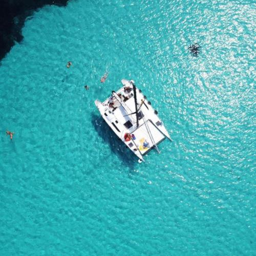 Catamaran and people in the Asinara sea