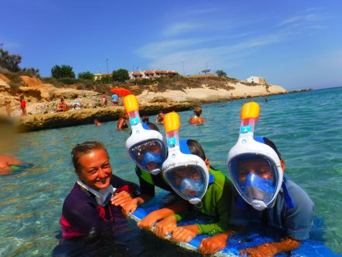 Children with instructor during snorkeling