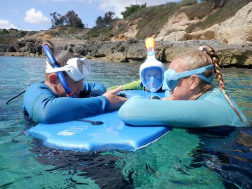 Guide with children during snorkeling excursion