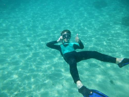 Child snorkeling in the crystal clear waters of Balai