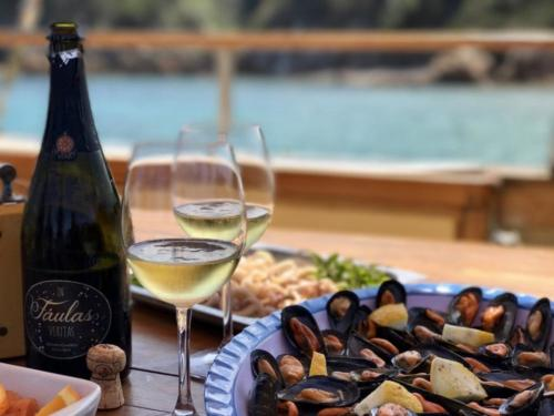 Aperitif based on fish and wine served aboard a vintage sailing ship