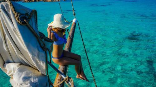 Girl aboard a vintage sailing ship