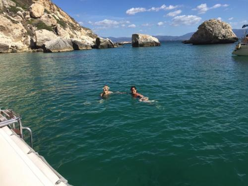 Hikers swim in the coast of Cagliari during raft tours