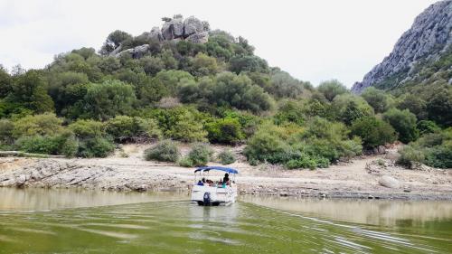 Boat sailing on the River Cedrino