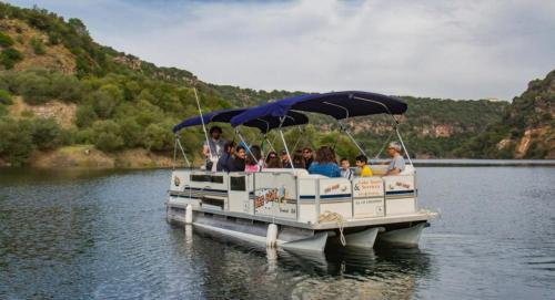 Hikers aboard a boat in the Cedrino river