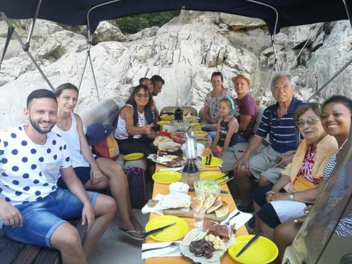 Group of hikers having lunch on board a boat