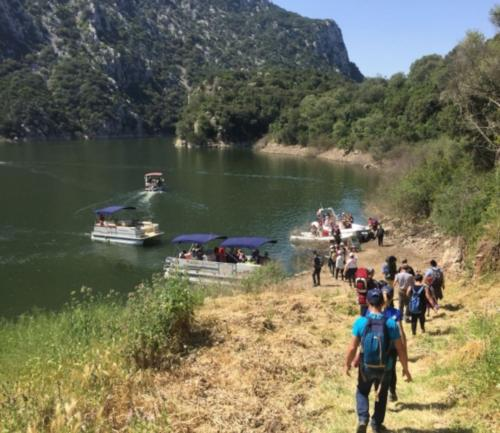 Hikers and boarding on the boat