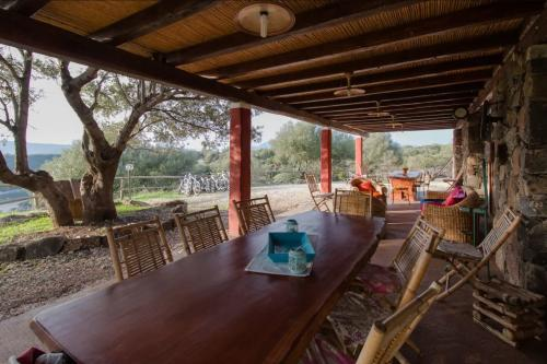 External veranda with table and chairs for relaxing in nature