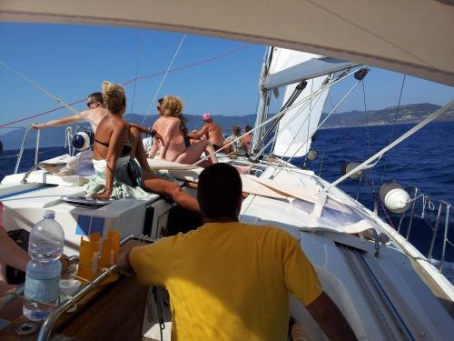 Passengers on board a sailing boat