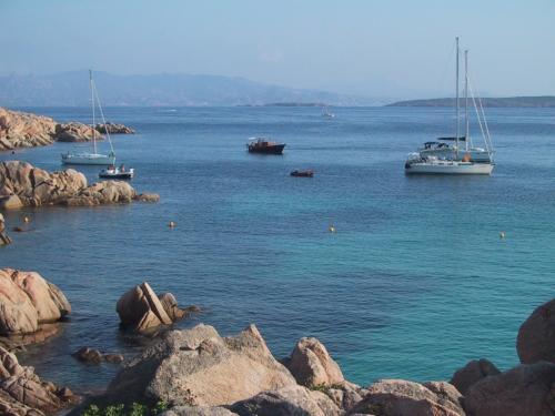 Sailboat in the coast of Bosa
