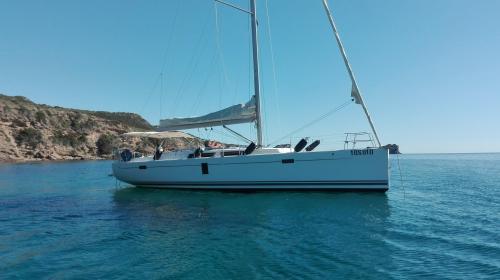 Sailboat sails in the sea of Bosa