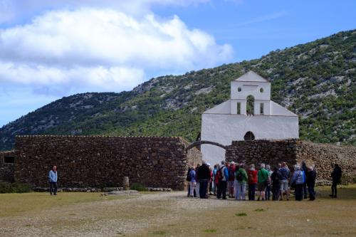 San Pietro church and hikers